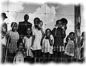 Township children behind fence