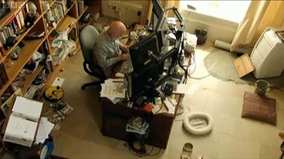 Terry Pratchett in his study