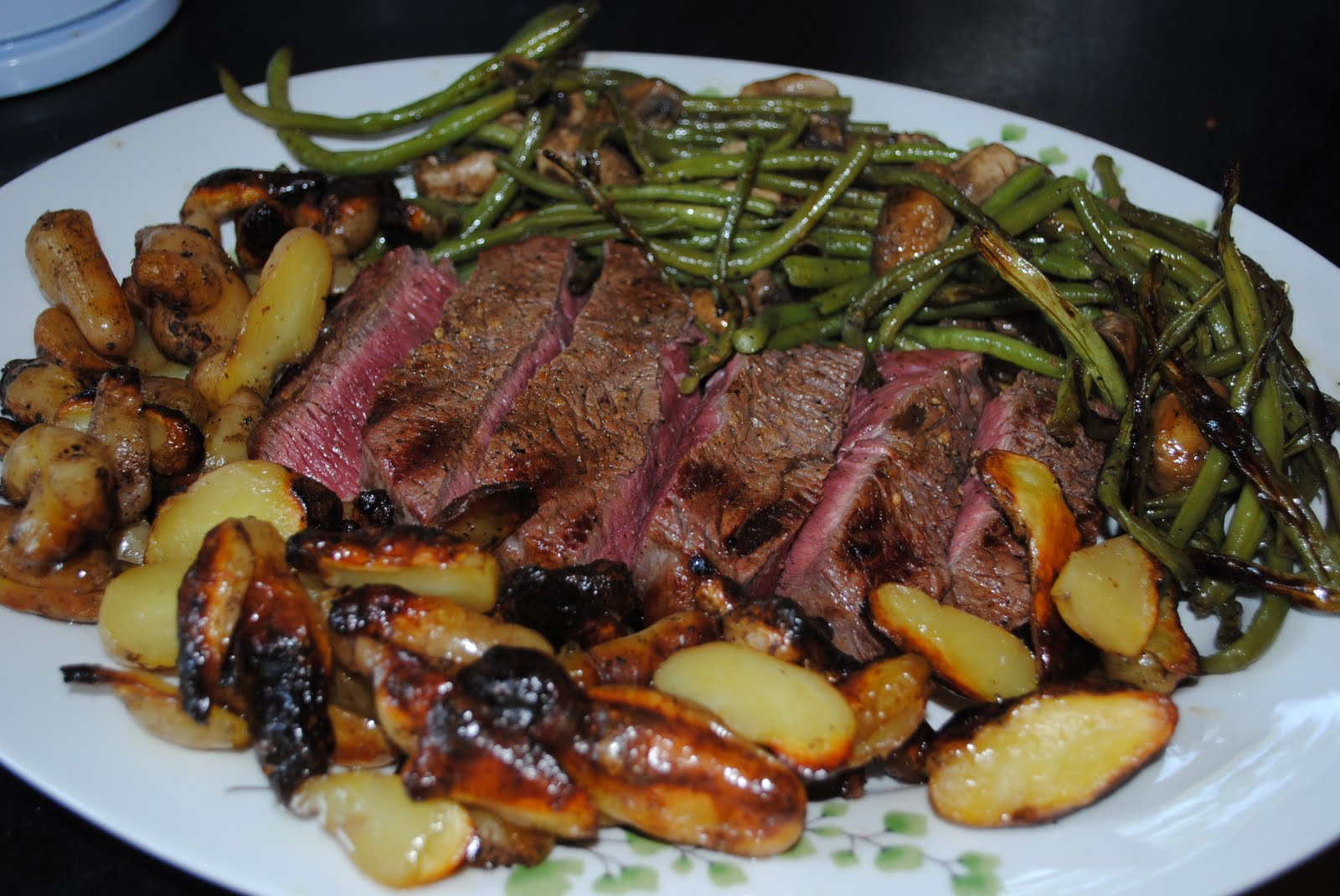 steak and potatoes and corn