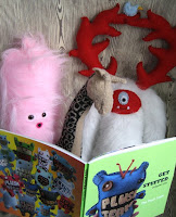plushies reading Plush Team annual