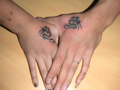 Cute small Tribal Dragon Tattoo Lovers' Cute Tribal Dragon Tattoo on hand