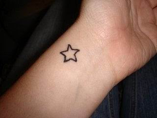 cute wrist star tattoo
