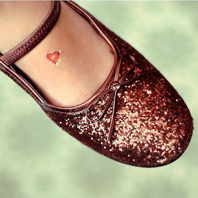 small tattoos for women on foot. Heart and star tattoos are the most popular tattoos in the girls.