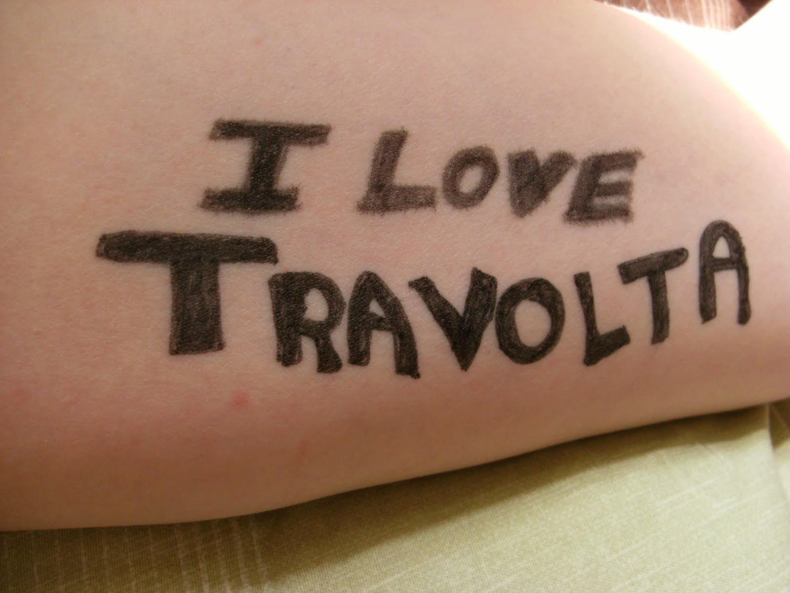 Left Inner-Arm: The words 'I love Travolta'.