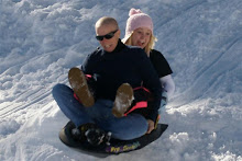 Madi and Mom sledding