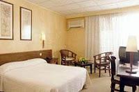 Le Mandarin Hotel room