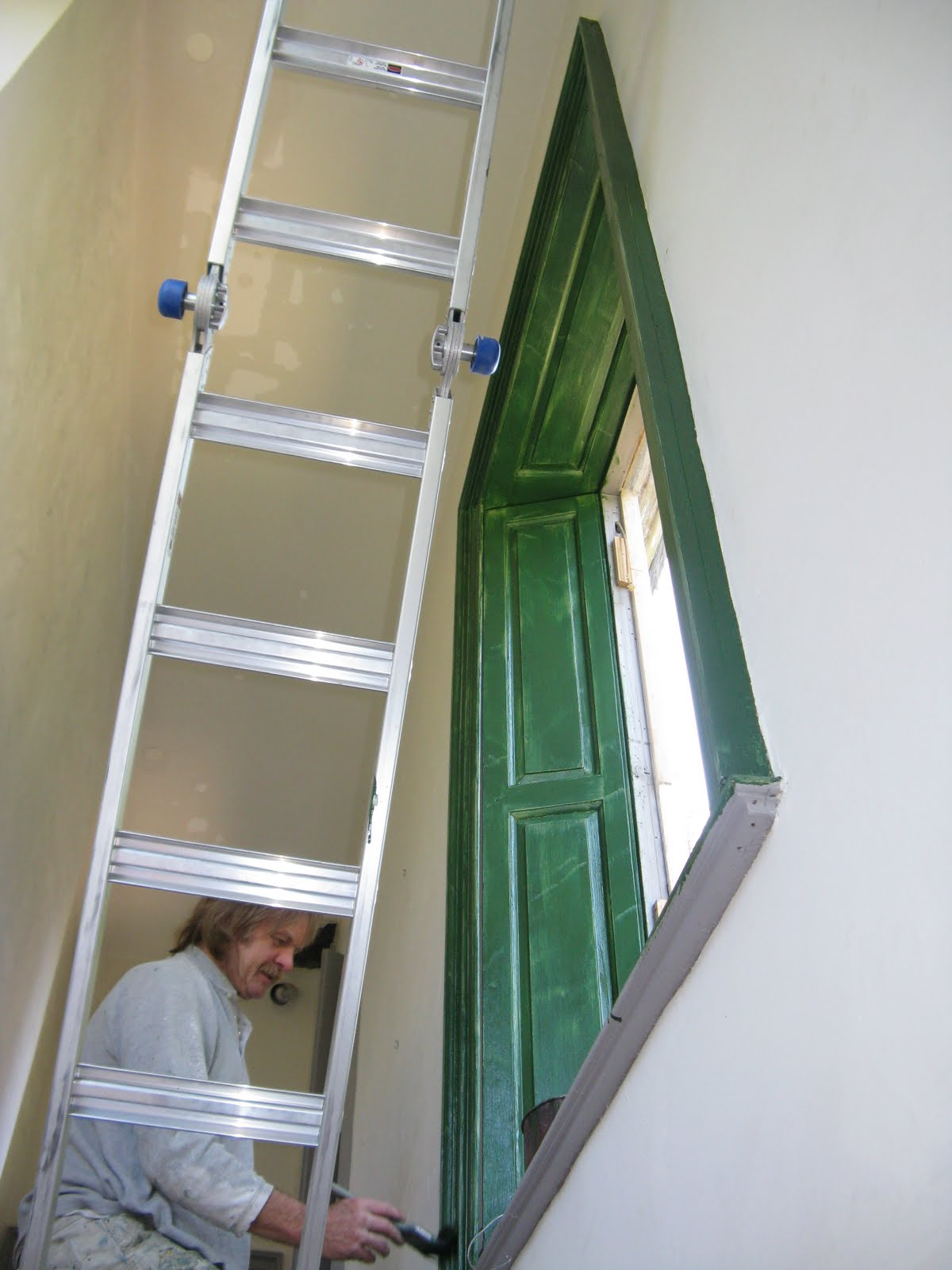 Traditional hand ground paint in the stair passage