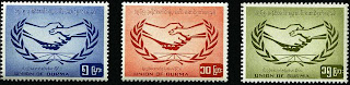 >waiting people and UN (stamps)