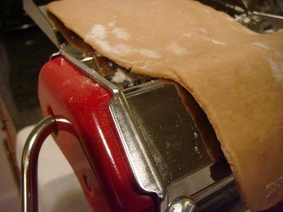 running cannoli dough through pasta machine