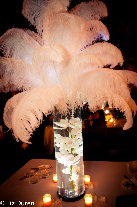 centerpieces with feathers for wedding tables