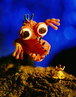Image of a googly toy monster frightening a much smaller toy figurine - (c) Grace Weston.