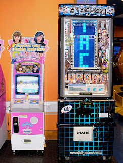Image of two one-switch arcade machines. Sega's Love and Berry and LAIGames Stacker Prize game.