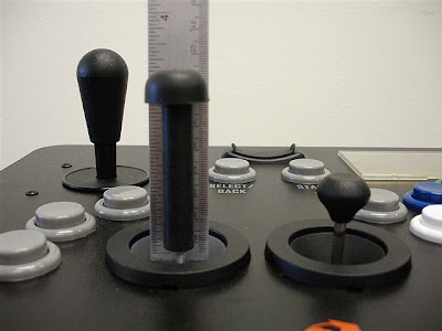 Image of Quasimoto 1P Arcade Stick with comparison between a standard analogue stick and an extended stick.
