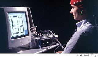 Image of a man playing a simple PC game with his mind.