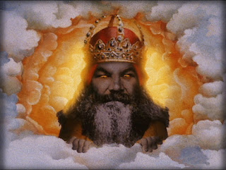 Image of a Monty Python representation of God poking his head through some clouds - looking stern.