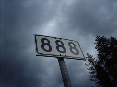 Image of a road-sign for route 888 - linking tenously to the BBC's original subtitling service accessed via paging 888 on their teletext service on analogue TVs.