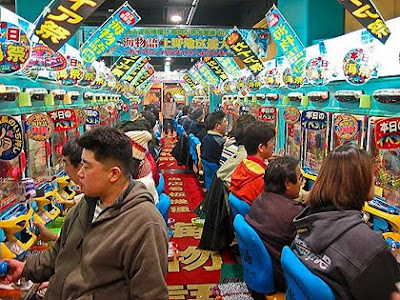 Image of a colourful Japanese Pachinko gaming parlour.