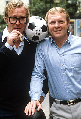 Image of Michael Caine and Bobby Moore in 1981 at a charity bash linked to the classic football film Escape to Victory.