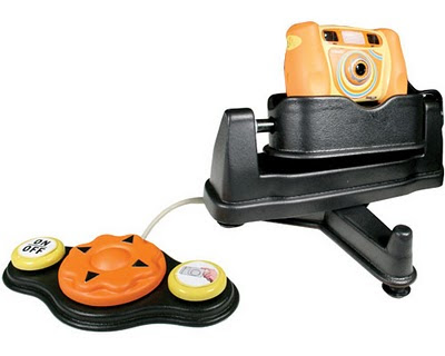Image of an orange VTech Kidizoom adapted digital camera, sitting on a black motorised tripod, all connected to a large control panel.