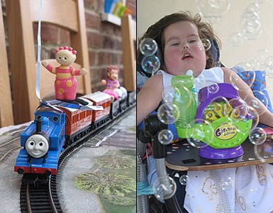Left image: Close up of the Thomas the Tank Engine set-up with some of Sophie's favourite toys taking a ride. Right image: Sophie activating her switch adapted bubble machine, surrounded by bubbles.