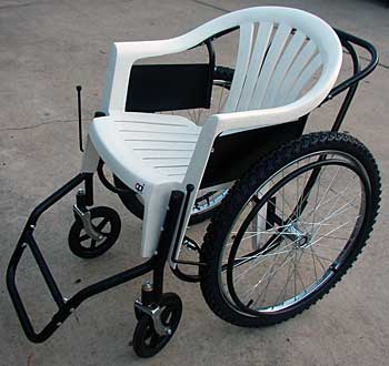 Image of a Free Wheelchair Mission chair consisting of some bike parts and a plastic garden chair.