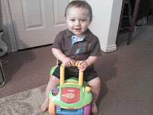 Trey and his new car!  This one's more his size.