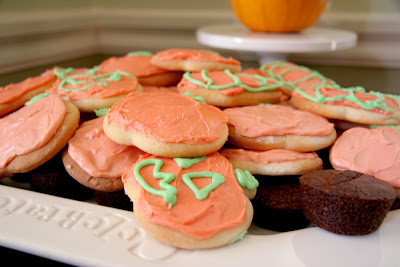 my friend mary makes the best halloween cookies they have cream cheese icing and are irresistable i think i ate about 5 or 6 that night