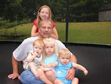 Grandpa with 4 of 5 grandkids.