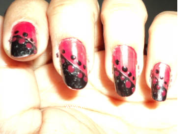 Nail art design in red and black