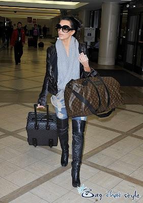 Kardashian  on Kim Kardashian Looks Totally Glam At The Airport With Louis Vuitton