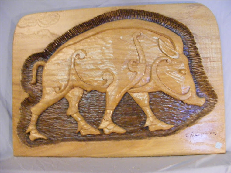 Wild Boar - relief carving in walnut