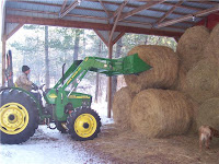 Using a Tractor to Move Round Bales