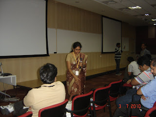 Hima Vejella giving goodies to audience