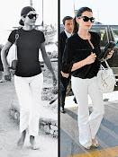 Anne Hathaway dressed like Jackie O.
