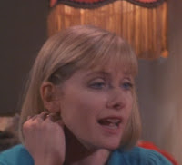 Barbara Crampton wearing clothes in her role as Megan