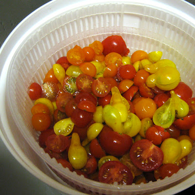 Spin sliced tomatoes in a salad spinner to remove seeds and excess juice