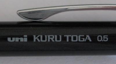 Kuru Toga logo