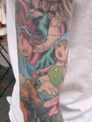Hands down, best tattoo we saw: complete arm sleeve with Digimon characters.