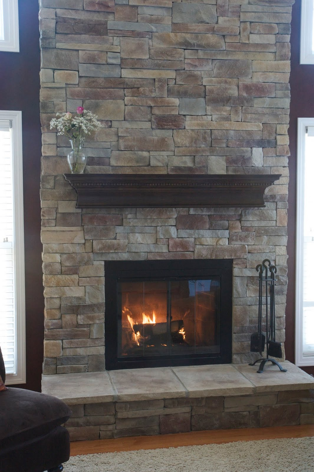 Brick fireplace refurbished with new stone veneer. The manufactured  title=