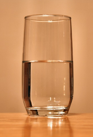 glass half full. this glass is half empty,