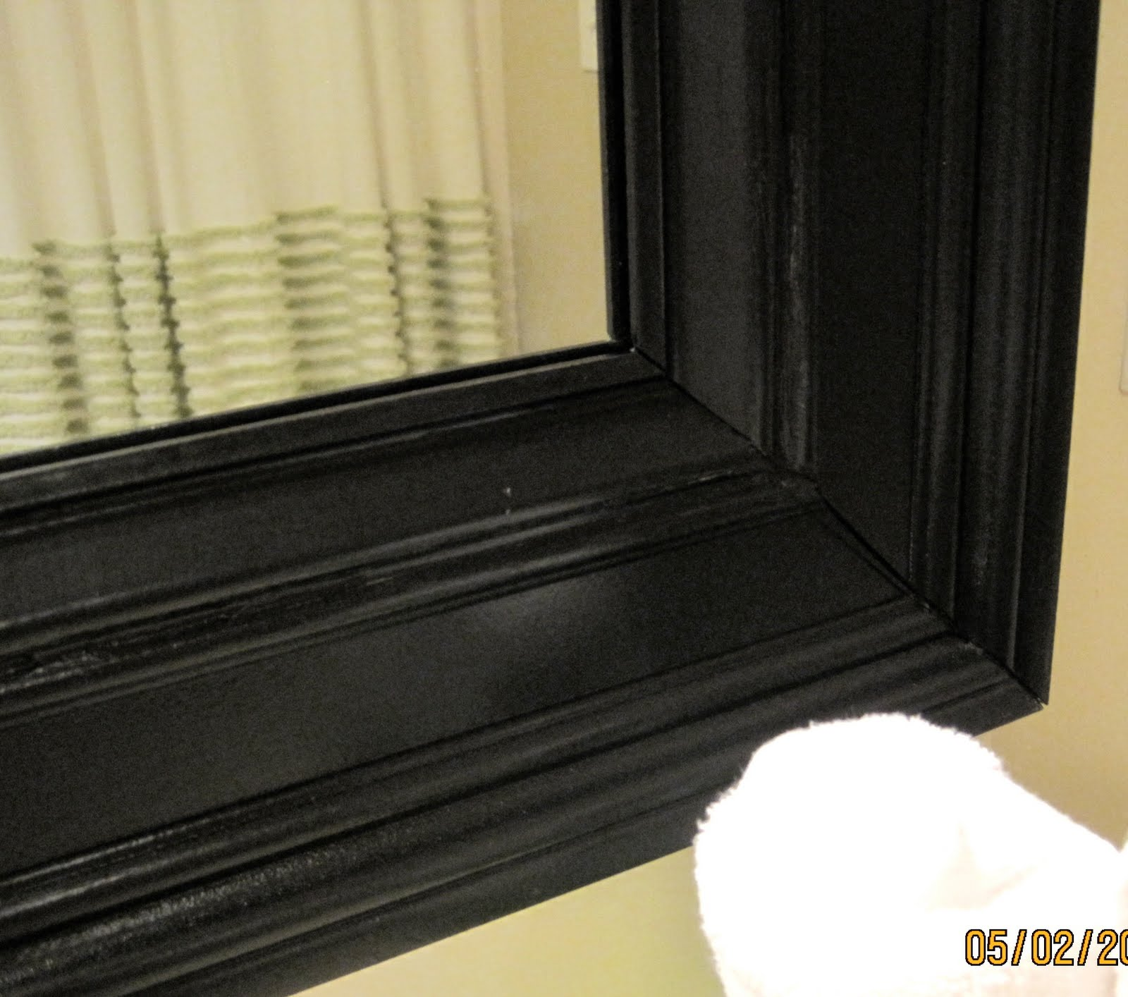 Bathroom mirror frame tutorial remodelaholic for How to frame mirror in bathroom