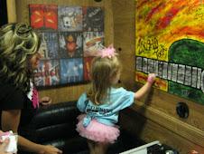 Eva signing Candy Coburns tour bus