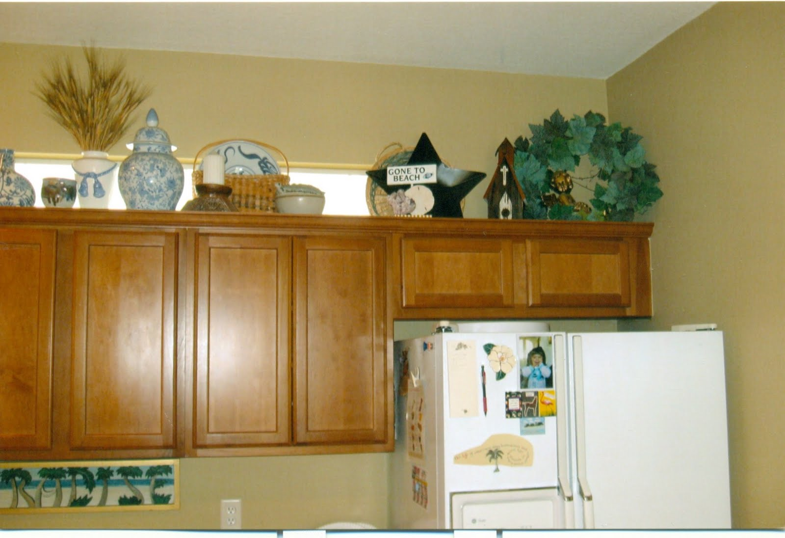 decorating above kitchen cabinets ideas afreakatheart