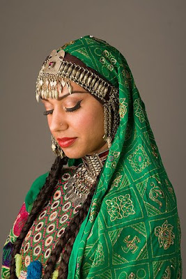 an Afghani woman in ornate dress