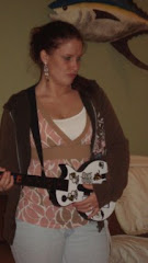 Linz playing Guitar Hero....she rocked too!