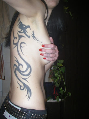 tribal dragon tattoos for girls. Tribal dragon tattoo design becomes very popular.