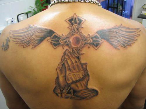 cross tattoos for men on back. ack tattoos for men wings.