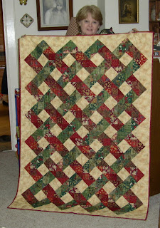 me holding my new red and green Christmas quilt