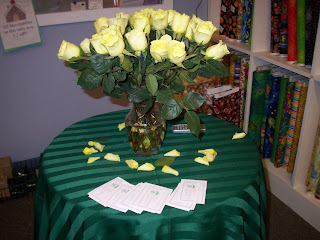 Vase on table with yellow roses