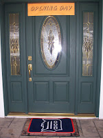 Makl front door with Opening Day sign above door and Tigers Welcome Mat on the porch